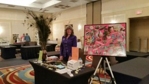 Sheryl with one of her vision boards at a women's conference